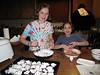 Alena and Elise preparing chicken