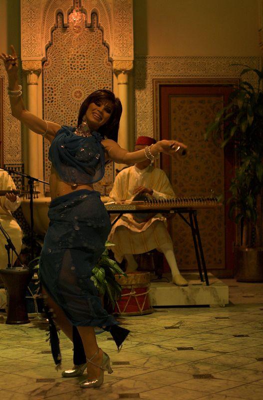 Belly dancer in restaraunt.