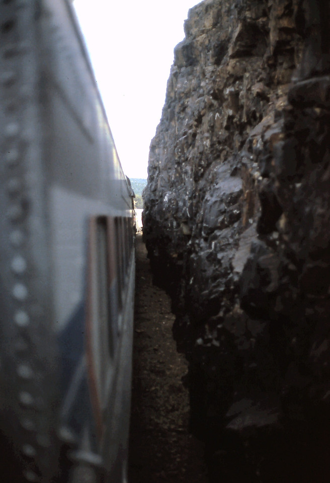 We are passing through a cut.  There was not much space between the train and the face of the rock.