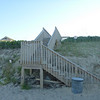 The oceanfront hotels are all behind enormous dunes, so these little wooden walkways provide a path to the beach . . .