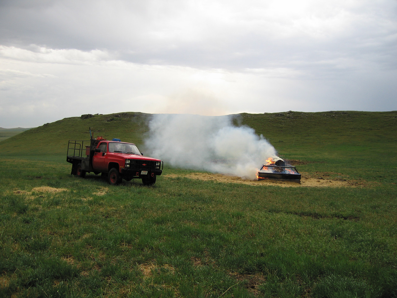 Shortly after we arrived at my parent's place, lightning hit a bale feeder...