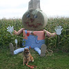 Ginger with either a farmer or train conductor (you decide) bale of hay display at Summerside, PEI.
