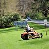 Modern lawn equipment. ..The beard is a requisite...