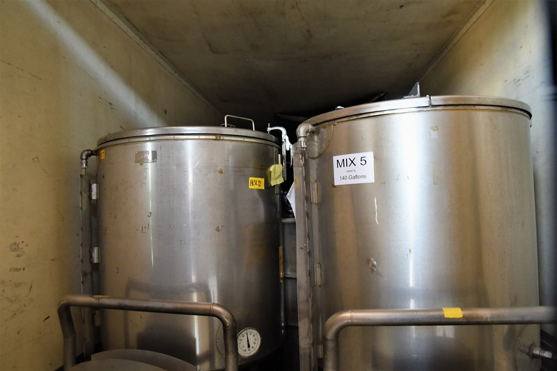 These 140 gallon containers are in a refrigerated trailer. They are transported over highways.