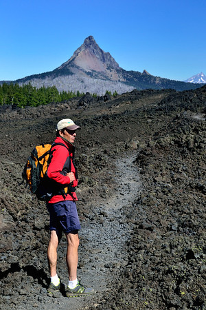 On the trail over the Belknap Crater lava fields at McKenzie Pass, Oregon.  Mt. Washington in the background.