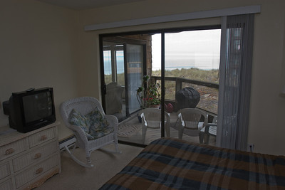 The master bedroom opens onto the deck and has great views of Monterey Bay to the west.