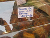 This translates:  Pork ribs, Texas Style.  The price is roughly $20 per pound