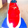 Rebecca in bobsled, front view.