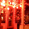 Rebecca under red lights on Main Street, Park City.