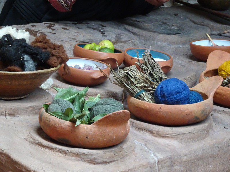 Dyed wool, along with the materials used for dyeing.