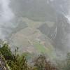 ...revealing Machu Picchu below