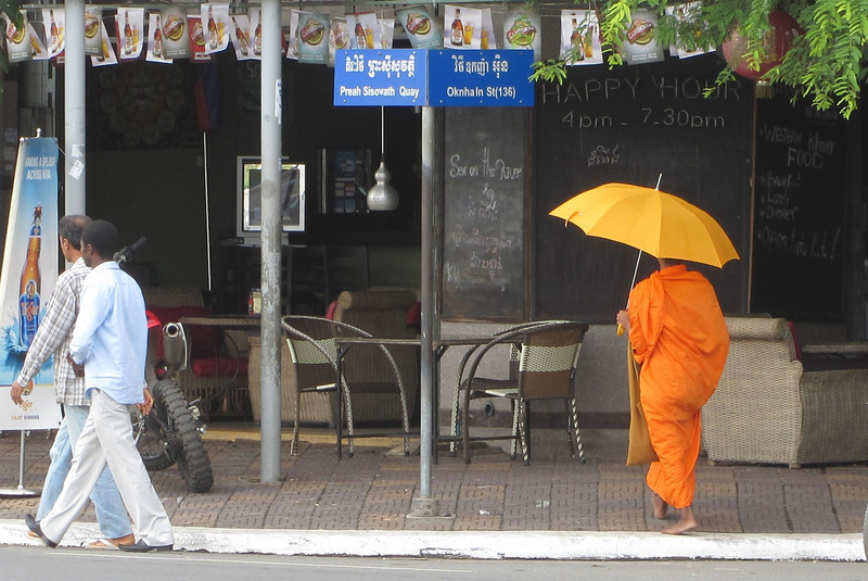 A Buddhist monk making his morning rounds. - Phnom Penh