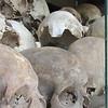 "Skulls on display inside the Choeung Ek ""Killing Fields"" Memorial."
