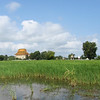 Buddhist Wat in a rice field near Udong Cambodia.