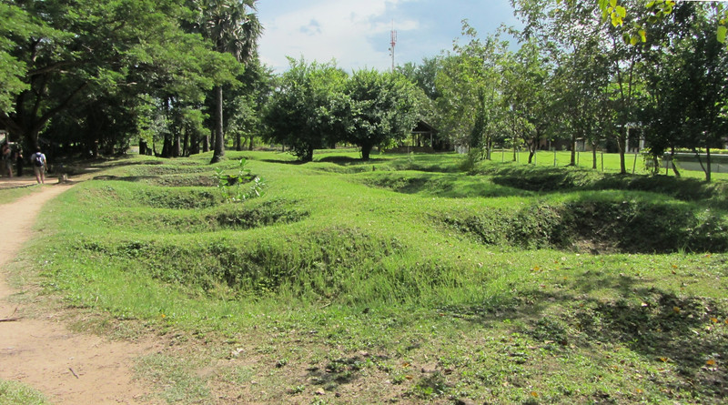 The Killing Fields.  Pits are the sites of mass burials of Khmer Rouge victims.