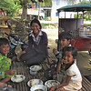 The family of my tuktuk dirver having lunch.<br /> I was invited to join them!