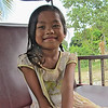Little Cambodian girl in a tuktuk.