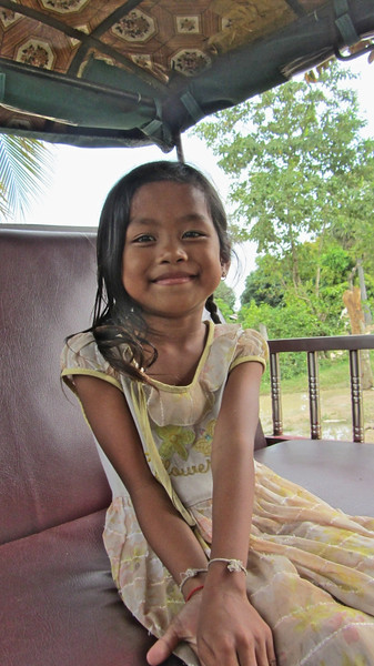 Little Cambodian girl in a tuktuk.