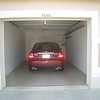 Garage with rental car. Our Suburu Outback fits in just fine, along with 2 bicycles and golf clubs.