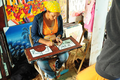 local artist working in her shop
