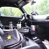 "When I think road trip I think camera bag with Hanover Sheriff decal (theft deterrent) marked blood!  ..Also, Starbucks coffee on the console and Red Bull in cup holder. ..Virginia State Police cap. ..And of course ""The Gypsy"" my GPS."