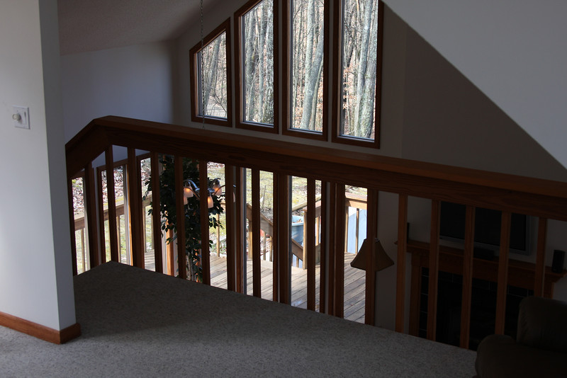 View from the master bedroom. The loft over looks the great-room with its fireplace and flat screen television.