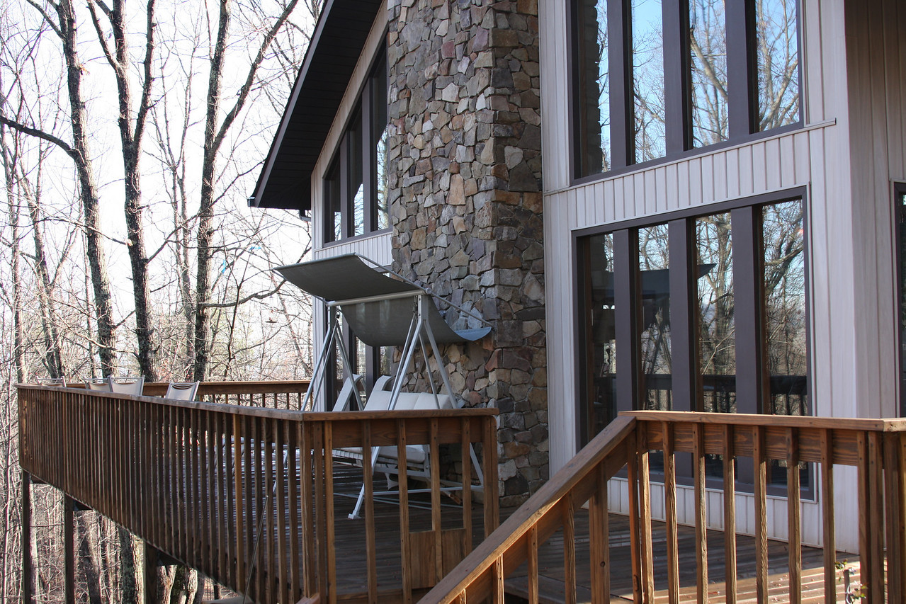 Rabbit Moon Cottage's front porch. The views are beautiful from the porch which wraps around both sides and the front of the cabin.