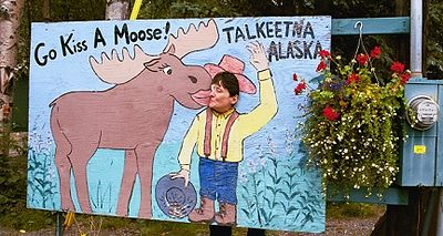 "Wendy kisses moose in Talkeetna. This was about the only ""touristy"" thing we found there (not that we were looking!)."
