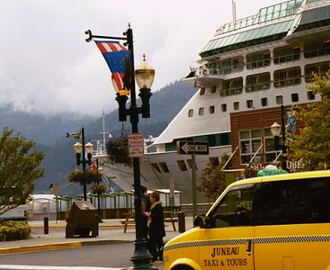 Day 8. Port of call Juneau: 10 am to 10 pm. The ship docks right in town and dominates the view toward the bay for the day, along with a couple of other large ships.