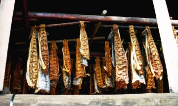 Salmon in a drying building in Chenna Village.