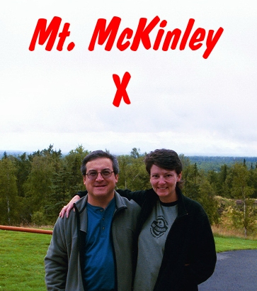 """X"" marks the spot where we hope to see Mt. Denali (McKinley) when and if the clouds clear. We're located just outside the hotel lobby on a hill only a couple of miles from downtown Talkeetna."