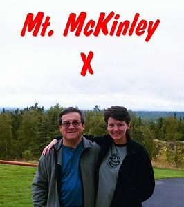 """""""X"""" marks the spot where we hope to see Mt. Denali (McKinley) when and if the clouds clear. We're located just outside the hotel lobby on a hill only a couple of miles from downtown Talkeetna."""