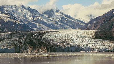 "The Hubbard Glacier, as it flows out of the St Elias Mountains into Disenchantment Bay. The Hubbard is one of the most active glaciers, nicknamed the ""Galloping Glacier"" in 1986 when it surged more than a mile and sealed off Russell Fjord."