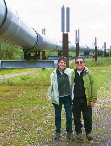 Day 2. Viewing the oil pipeline near Fairbanks. Oil is pumped from Prudhoe Bay in the Arctic to the Valdez tanker terminal where it is transferred to ships. The pipeline is about 800 miles long and has 12 pumping stations. The first oil was arrived at Valdez in 1977. Notice the two parallel heat radiators at the top of each support (dark red). These prevent ambient heat from being transferred downward toward the permafrost. About half of the pipeline is above ground.