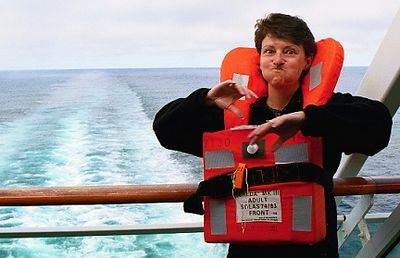 Day 7. We're heading toward the Hubbard Glacier (no port stop) and Wendy's practicing for the mandatory safety drill. Every cabin is equipped with several life preservers.