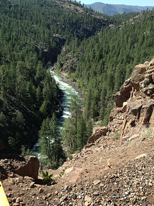 The rail line and the Animas river run in the same valley, very close to each other.