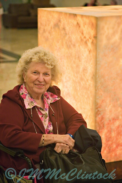 My Mother in the upper lobby of the Grand Sirenis.  My Dad suggested that she was most appropriately placed next to a square.