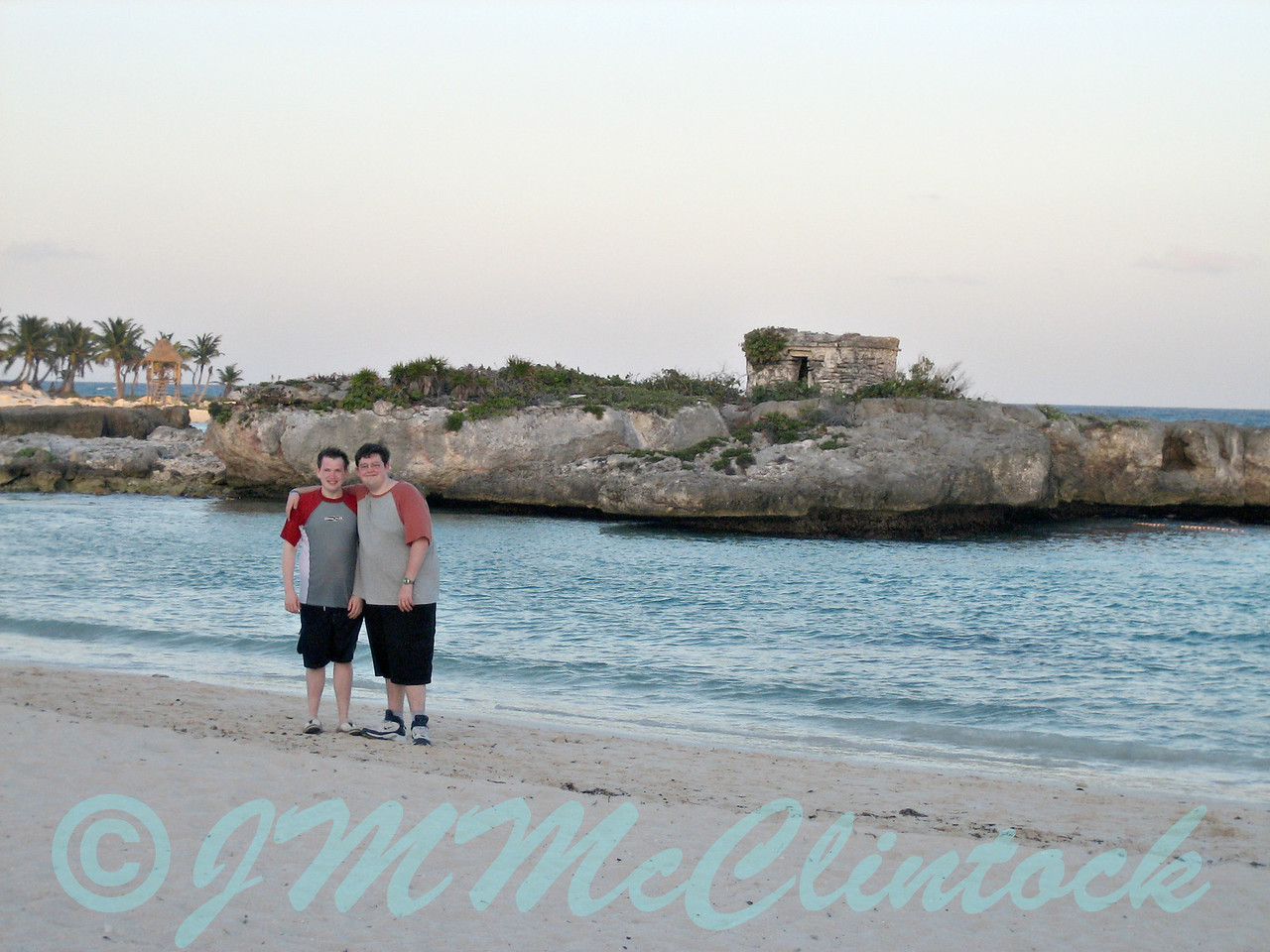 James and Stephen on the beach.  The ruins of  Spanish lookout building is on the little island in the background.