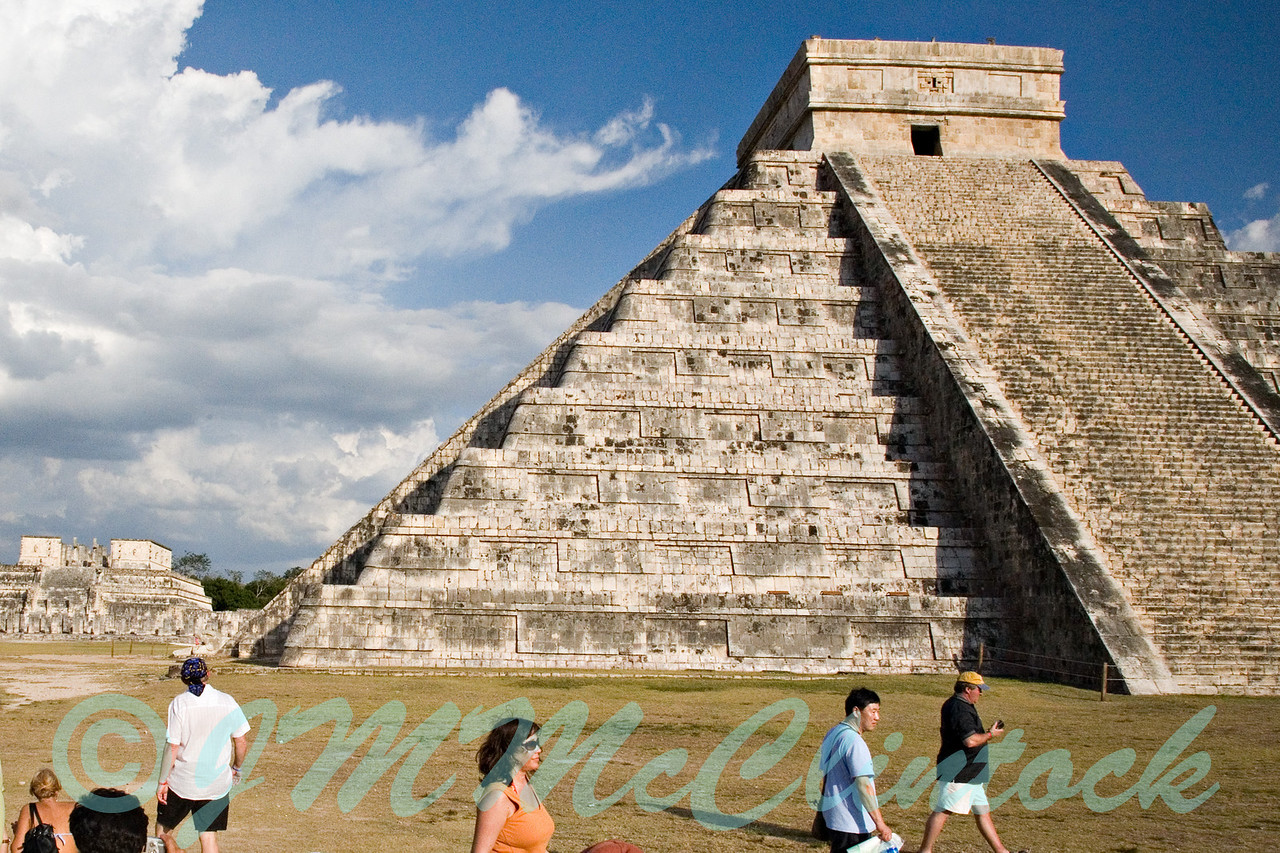 This picture of the Mayan pyramid was taken just before sunset on March 22nd, the day following the Equinox.  The Equinox held special significance to the Mayans.  The pyramid was designed such that on the equinox a series of light and dark shadows crawl down the staircase on the left as the sun sets emulating a snake.  This also is seen to a slightly lesser degree on the day before and after the Equinox.  If you look on the staircase on the left you can see the bright areas set off by shadows forming the body and extending to the head of the snake