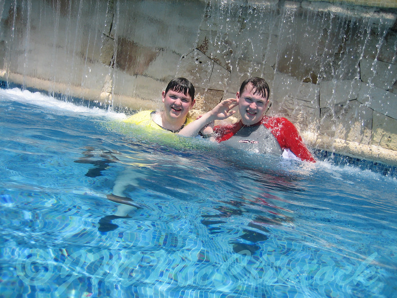 Boys relaxing in the upper pool.