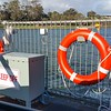 Car on ferry crossing the River Murray