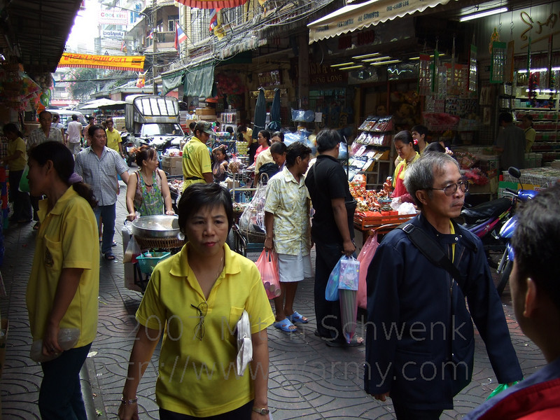 A very bustling shopping area in Chinatown.  Yellow shirts are worn on Mondays to honor the king of Thailand.