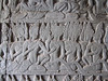 A close up of some of one of the stories on the outside wall to Ankor Wat.