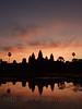 Watching the sunrise behind Ankor Wat, near one of the swimming pools.