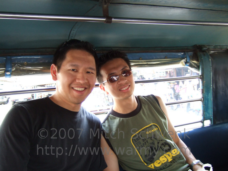 Albert and Chris riding in a jeepney.