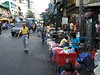 Street vendors line the streets of Chinatown - selling both goods and food.