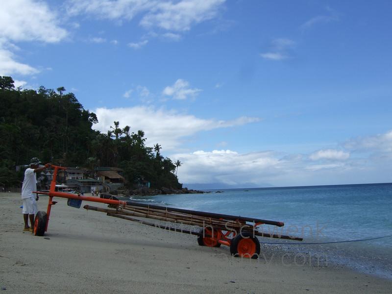 Boat carrier.  Beautiful beach scenes on White Beach, Puerto Galera, Philippines.
