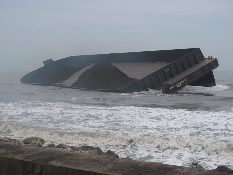 The rainy season on the west coast can be stormy and dangerous to shipping.  Here we came across a coal barge that was grounded near the beach and locals were salvaging the coal that had dumped overboard onto the beach.
