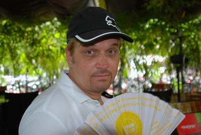 Wes cooling down below lunch (outdoor restaurant in Ho Chi Minh City)