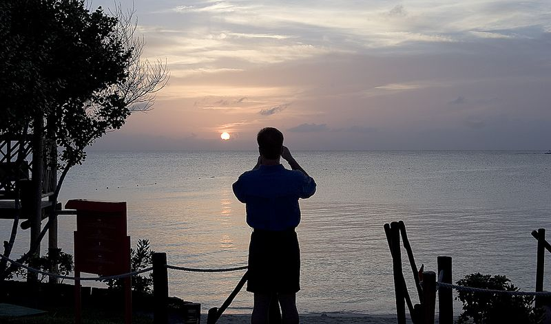 Everyone takes a picture of the sunset in Cozumel